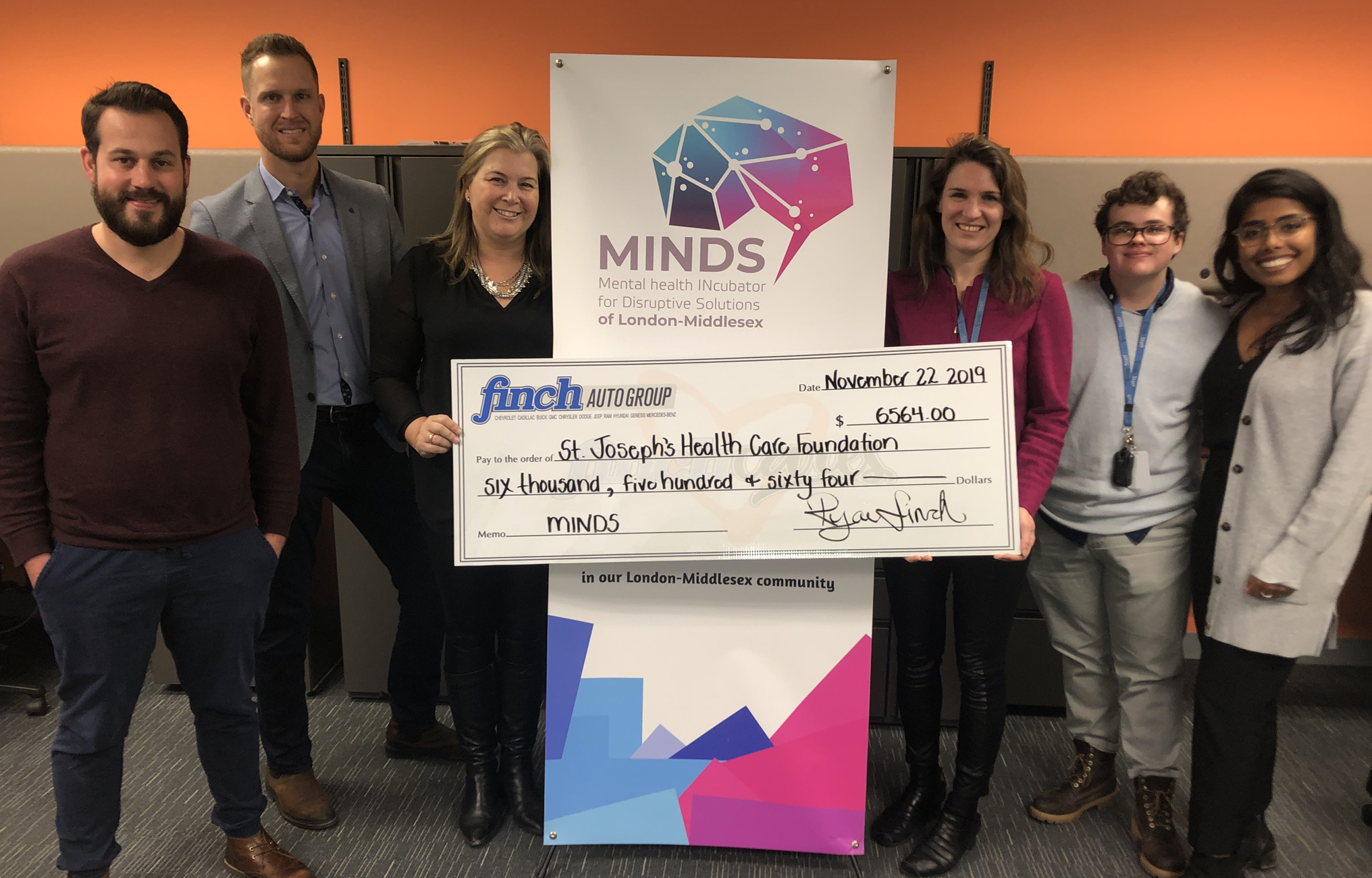 Cheque presentation at MINDS